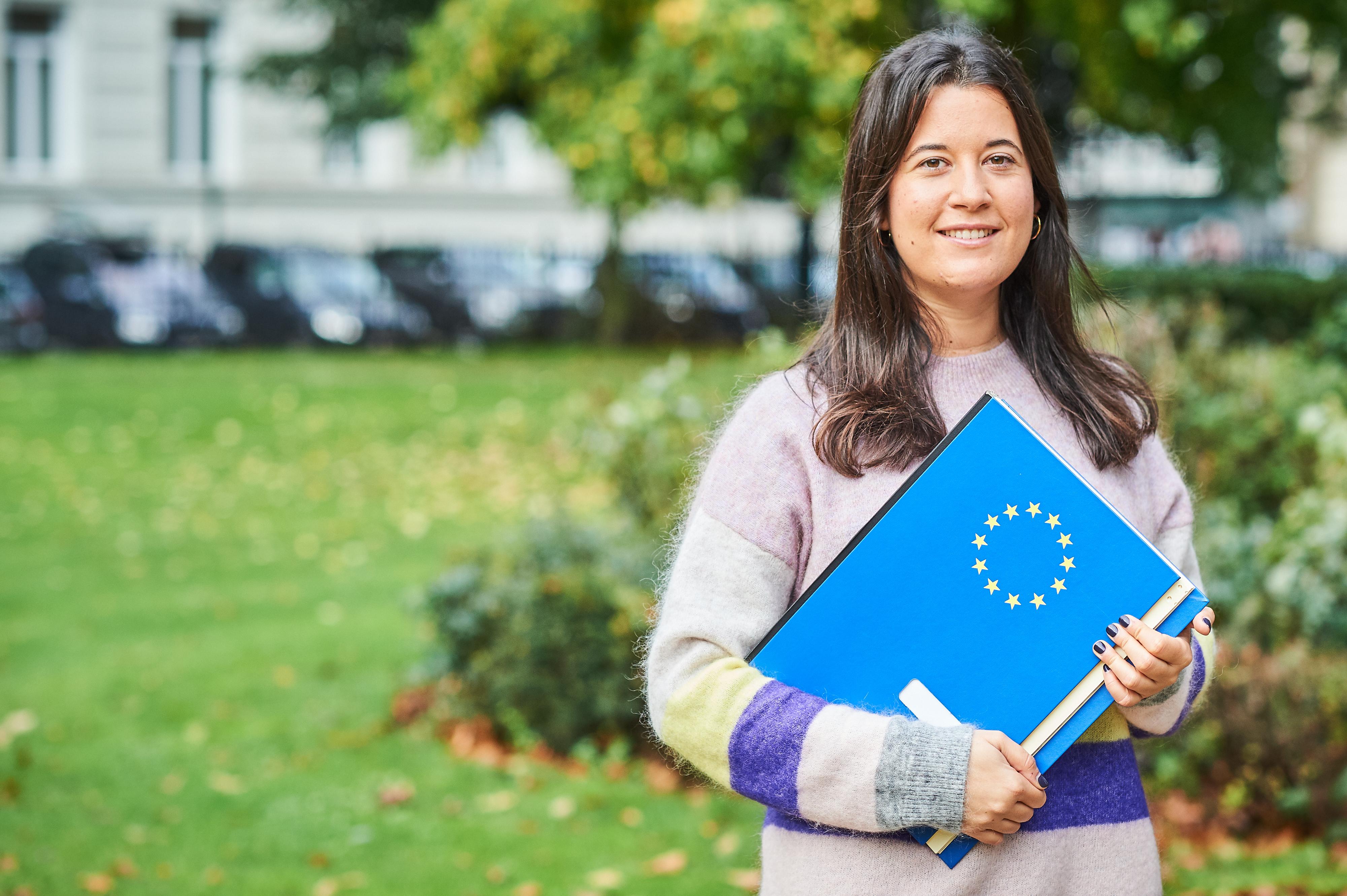 Woman holding an EU folder