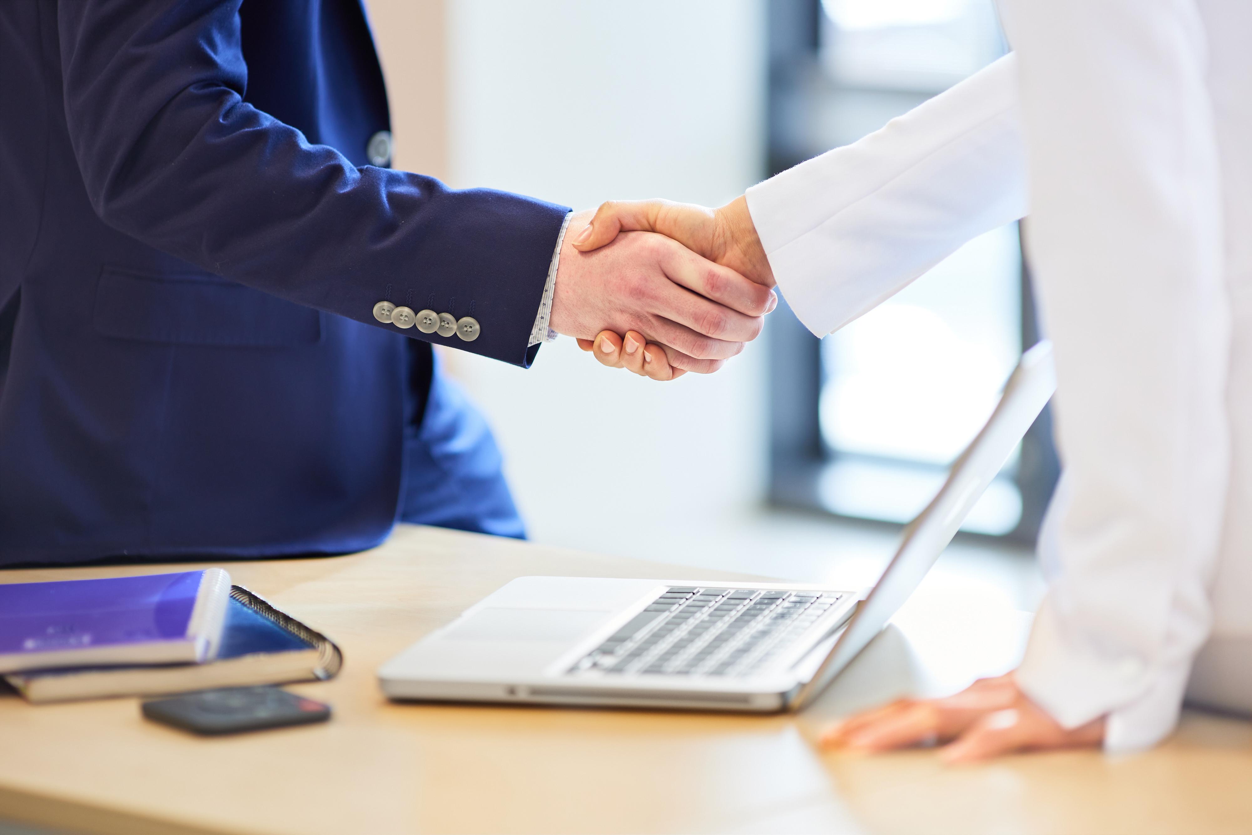 Handshake between two colleagues